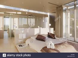 Modern Master Bedroom With Bathroom Design Trendecors Bed And Bathroom In Modern Master Bedroom Stock Photo Alamy