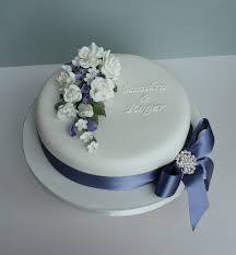 Elegant White Single Tier Wedding Cake Decorations bined With Lovely Navy Blue Ribbon And Beautiful