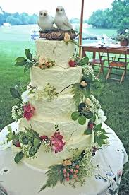 Rustic Buttercream Wedding Cake With Fresh Flowers And Fruit