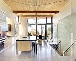Kitchen Island Seating Example Of A Coastal Galley Concrete Floor Eat In Design With