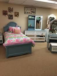 Ashley Zarollina Upholstered bedroom set the showroom floor at