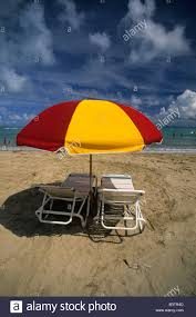 Beach Lounge Chair And Red And Yellow Umbrella On The Atlantic Ocean ... Atlantic Lounge Chair Bernhardt Design Fniture Hivemoderncom Intertional Home Set Of 2 Wicker Alinum Chaise Virgin Upper Class At Newark Liberty Bar Patio Lounge Contemporary Lifestyle Florida Preview Modern Theme Ecommerce Website Template Grey Deluxe Outdoor Armchairs Armchair Shop Renaissance Partner Free Shipping Today Atlantic From Architonic