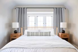 Spindle Headboard And Footboard by Ask The Audience Master Bed In Front Of Window Emily Henderson