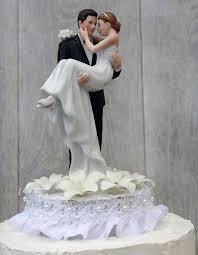 Stephanotis Groom Holding The Bride Wedding Cake Topper