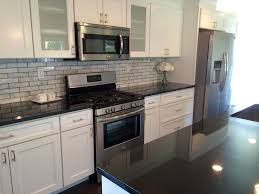 2x8 subway tile backsplash transitional black white kitchen by blankspace llc pittsburgh