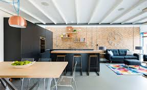 Combining The Kitchen Dining And Living Spaces Maximises Limited Space Natural Lighting Industrial Style Used Throughout Unites Areas