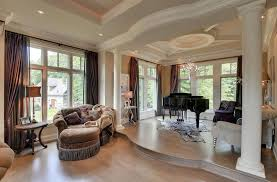 Traditional Sunken Living Room With Columns And Tray Ceiling
