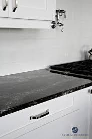 cambria ellesmere black quartz countertop white kitchen cabinets