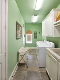 laundry room with ceramic floor tiles and green wall colors
