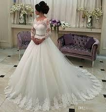 Perfect 2017 New Long Sleeve A Line Wedding Dresses Illusion Tulle Appliques Lace Vintage Dress Beaded Sash Bridal Gowns Luxury Online