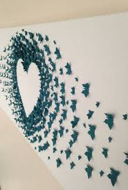 Decorating The Walls Of Paper Butterflies