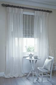 dublin roman blind with clare voile curtains on pole office