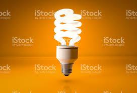 energy saving light bulb on orange background stock photo istock