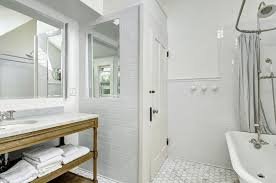 traditional bathroom with tile floors wall sconce in