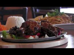 grille cuisine owner brings international cuisine to the hideout bar grille
