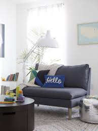 Table Sofa Pillows Lamp Rug Books Frame
