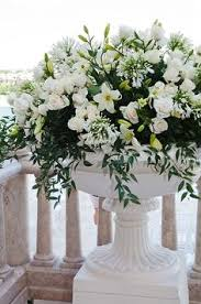 Fresh White Lilies And Roses Paired With Lush Greens Make An Elegant Statement In Over
