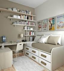 Space Saving Furniture For Small Spaces Along With Single Bed Which Has Storage Drawers And Wooden Floating Bookshelves Plus White Table Chair