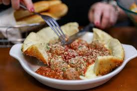 Olive Garden cheesy Meatball Pizza Bowl now on the menu TODAY