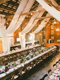 Drape The Ceilings Rustic Barn Wedding Reception Space With Draped White Fabric Decor