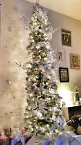 Snow Flocked Slim Christmas Tree by Best 25 Skinny Christmas Tree Ideas On Pinterest Tall Skinny