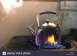 Steaming Water In Traditional Metal Kettle On Fire Gas Stove Kitchen