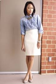 white pencil skirt paired faded denim blouse fall