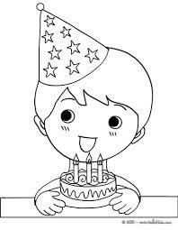 Boy Blowing His Birthday Cake Candles