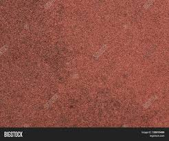 Red Protective Rubber Coating For Sports And Children Playgrounds Close Up Texture Background