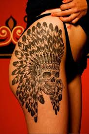 A Thigh Tattoo With Skull Portrait The Feather Made Headdress Reminds You Of Native