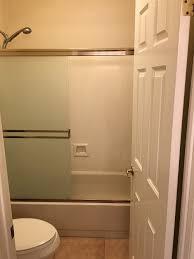 bathtub shower door versus splash guard