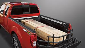 Silverado Bed Extender by Nissan Frontier Pro 4x King Cab Shown In Lava Red With Sliding