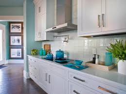 Minimalis Aqua Kitchen Decor With White Wooden Cabinet And Large Window Also Stone Tile