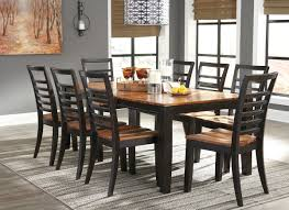 The Quinley Two Tone Brown 9 Pc Rectangular Dining Room Butterfly