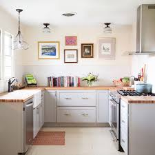 Inspiration For A Small Farmhouse U Shaped Painted Wood Floor And White Kitchen Remodel