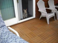 Kontiki Deck Tiles Canada by Interlocking Deck Tiles In A Hatch Pattern With An Ebony Border