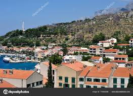 100 Birdview Of Podgora With Port And Monument Seagulls Wings Stock