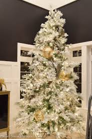 Flocked Christmas Trees Decorated by How To Decorate Your Christmas Tree Like A Pro Style House