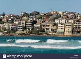 100 Bondi Beach House Surfer On Wave With Beach Houses In Background On Stock