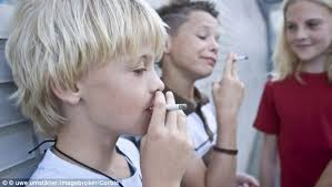 men who smoke regularly before the age of 11 have fatter sons new