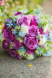Beautiful purple rose bouquet Love the tiny light blue flowers