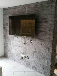 wohnzimmer steinwand grau wohndesign hausdesign