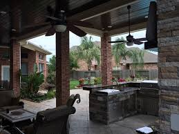 High Outdoor Wood Ceiling Kitchen and Fireplace with Seating