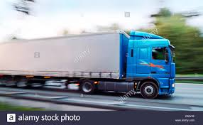 Trucks In Motion On German Motorway Stock Photo: 210343369 - Alamy