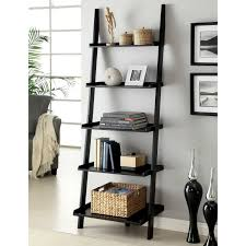 black wooden leaning ladder books shelves placed on the gray wall