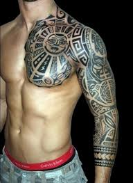 Tribal Tattoo Design That Covers The Whole Arm And One Side Of Chest