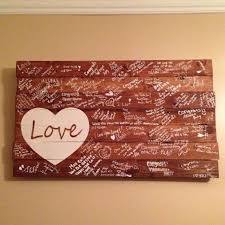 Paint A Rustic Slab Of Wood As Guest Book Alternative
