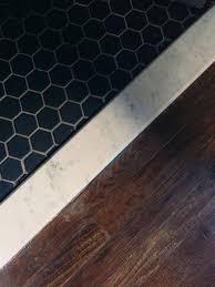 Tiling A Bathroom Floor On Plywood by Black Hex Tile Marble Threshold Wood Floor Alice Gao The Dean