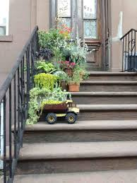 Quirky Playful Greenery Planters Gardens And Plants Painted Clay S Secured To Keystone Wall With Hanga Hangers Dump Truck Flower Pot