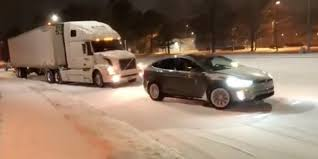 100 Trucks In Snow Elon Musk Shares Credible Video Of Tesla Model X Pulling A Truck